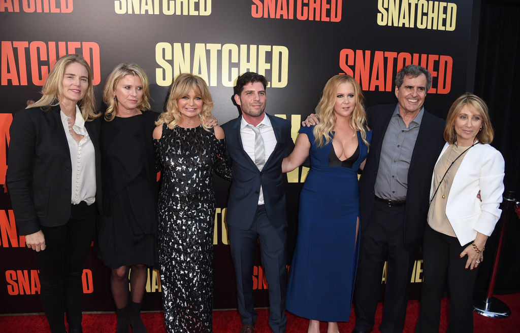 ". LOS ANGELES, CA - MAY 10:  (L-R) Emma Watts, President of Production, 20th Century Fox, producer Jenno Topping, actress Goldie Hawn, director Jonathan Levine, executive producer/actress Amy Schumer, producer Peter Chernin and Stacey Snider, Chairman/CEO 20th Century Fox arrive at the premiere of 20th Century Fox\'s ""Snatched\"" at the Village Theatre on May 10, 2017 in Los Angeles, California.  (Photo by Kevin Winter/Getty Images)"