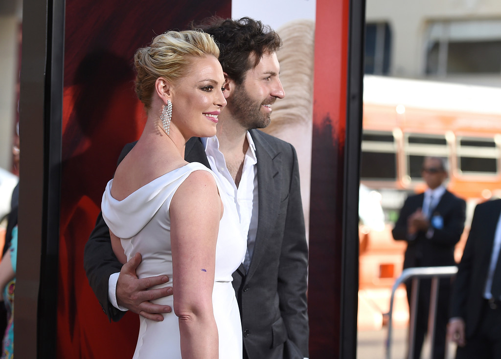 ". Katherine Heigl, left, and Josh Kelley arrive at the Los Angeles premiere of ""Unforgettable\"" at the TCL Chinese Theatre on Tuesday, April 18, 2017. (Photo by Jordan Strauss/Invision/AP)"