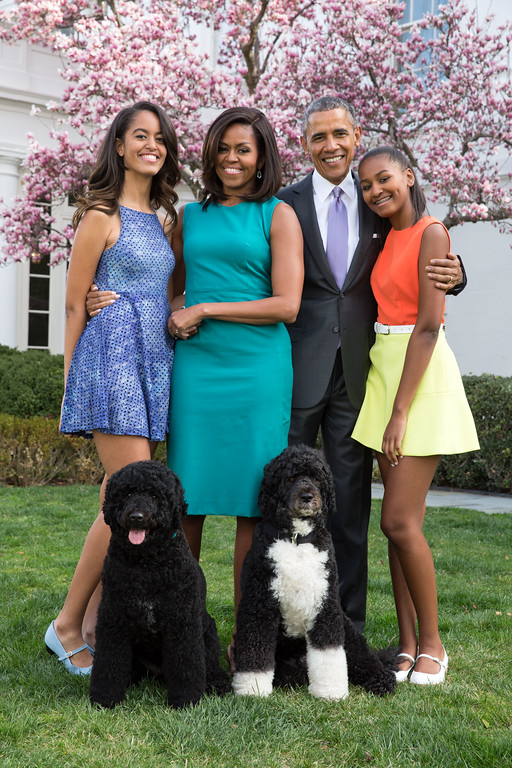 . WASHINGTON, DC - APRIL 05: U.S. President Barack Obama, First Lady Michelle Obama, and daughters Malia (L) and Sasha (R) pose for a family portrait with their pets Bo and Sunny in the Rose Garden of the White House on Easter Sunday, April 5, 2015 in Washington, DC. (Photo by Pete Souza/The White House via Getty Images)