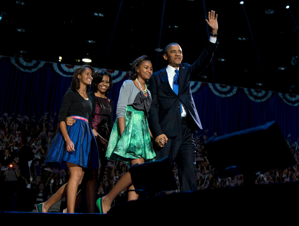 . President Barack Obama, accompanied by first lady Michelle Obama and daughters Malia and Sasha arrive at the election night party Wednesday, Nov. 7, 2012, in Chicago. Obama defeated Republican challenger former Massachusetts Gov. Mitt Romney. (AP Photo/Carolyn Kaster)