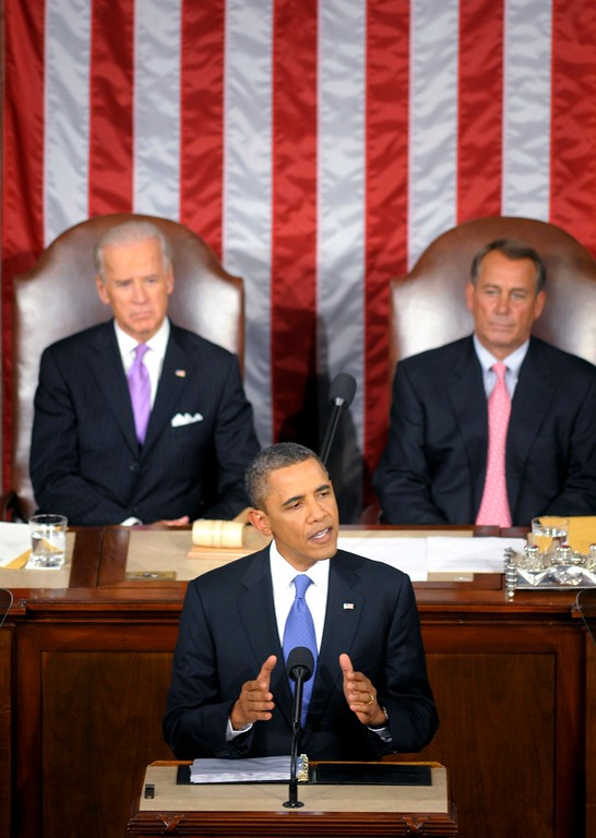 . President Barack Obama delivers a speech to a joint session of Congress at the Capitol in Washington, Thursday, Sept. 8, 2011. Watching are Vice President Joe Biden and House Speaker John Boehner.  (AP Photo/Cliff Owen)