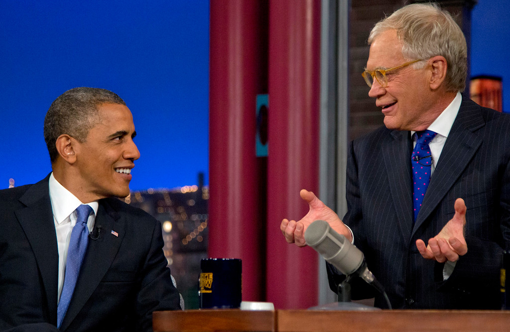 ". President Barack Obama talks with David Letterman on the set of the ""Late Show With David Letterman\"" at the Ed Sullivan Theater, Tuesday, Sept. 18, 2012, in New York.  (AP Photo/Carolyn Kaster)"