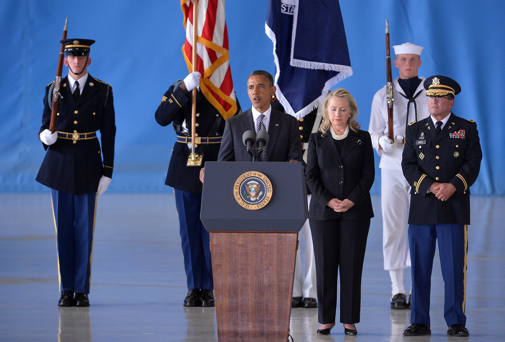 . US President Barack Obama (C) speaks as Secretary of State Hillary Clinton looks on during the transfer of remains ceremony marking the return to the US of the remains of the four Americans killed in an attack this week in Benghazi, Libya, at the Andrews Air Force Base in Maryland on September 14, 2012. US Ambassador Christopher Stevens died on Tuesday along with three other Americans in the assault on the consular building in Benghazi, on the 11th anniversary of the September 11 attacks. (JEWEL SAMAD/AFP/GettyImages)