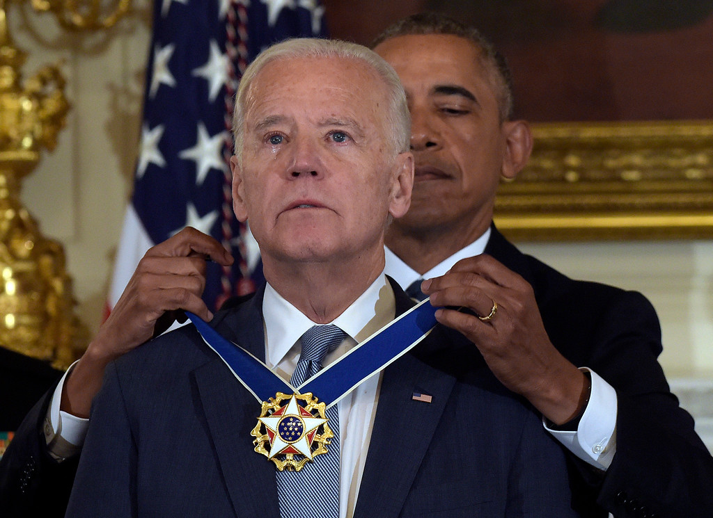 . President Barack Obama presents Vice President Joe Biden with the Presidential Medal of Freedom during a ceremony in the State Dining Room of the White House in Washington, Thursday, Jan. 12, 2017. (AP Photo/Susan Walsh)
