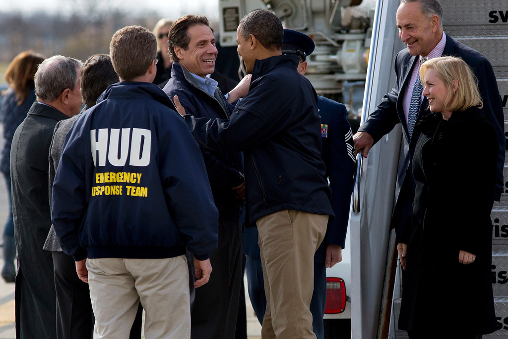 . President Barack Obama is greeted by New York Gov. Andrew Cuomo upon his arrival at JFK International Airport in New York Thursday, Nov. 15, 2012, before taking a aerial tour of damage along the New York coastline in the of Superstorm Sandy. From left are, New York City Mayor Michael Bloomberg, Housing and Urban Development Secretary Shaun Donovan, in HUD jacket, Cuomo, the president, Sen. Kirsten Gillibrand, D-N.Y., and Sen. Charles Schumer, D-N.Y. (AP Photo/Craig Ruttle)
