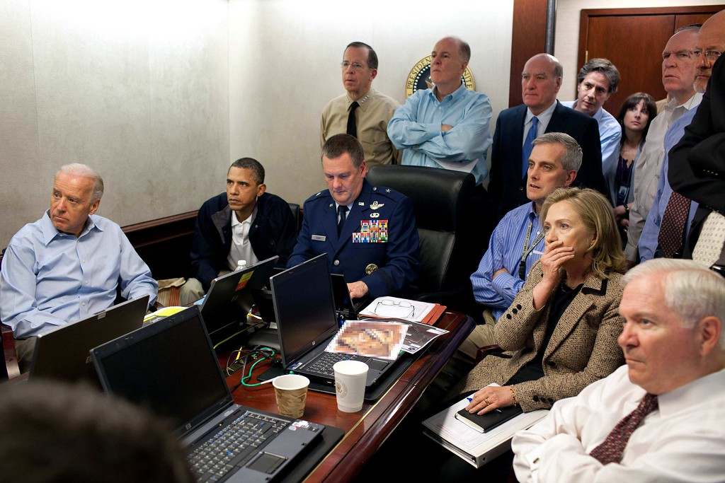 . FILE - In this May 1, 2011 image released by the White House and digitally altered by the source to diffuse the paper in front of Secretary of State Hillary Rodham Clinton, President Barack Obama and Vice President Joe Biden, along with with members of the national security team, receive an update on the mission against Osama bin Laden in the Situation Room of the White House in Washington. (Pete Souza/The White House via AP)