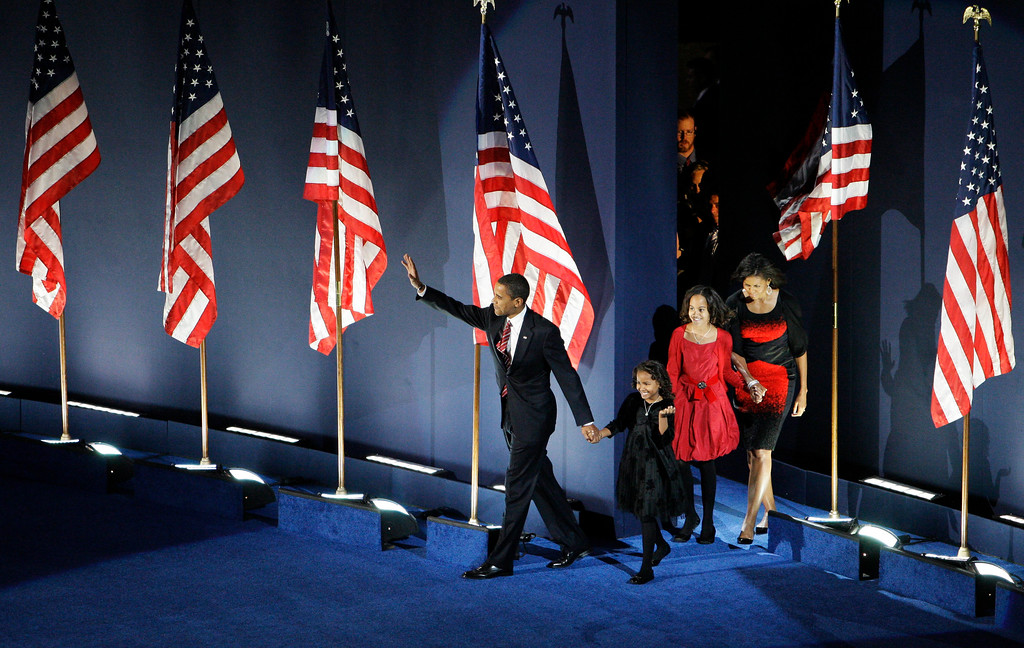 . President-elect Barack Obama walks out on stage with his family to speak at his election night party at Grant Park in Chicago, Tuesday night, Nov. 4, 2008.  (AP Photo/Alex Brandon)