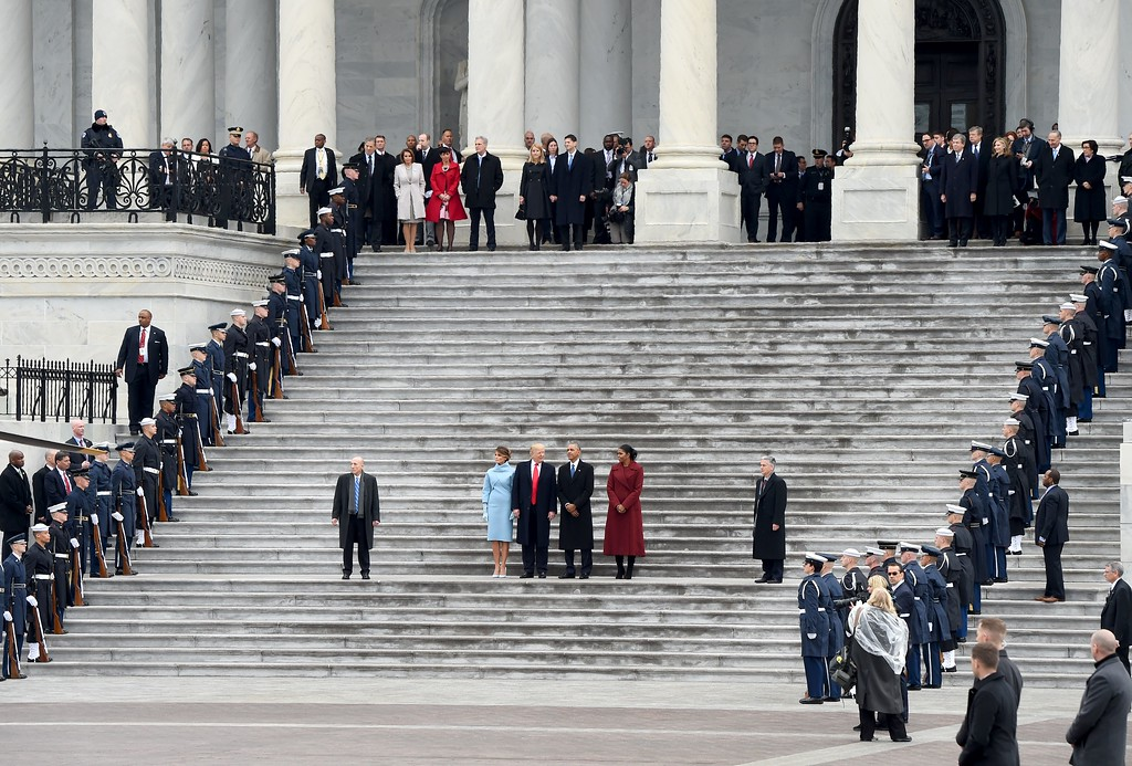 . US President Donald Trump and First Lady Melania Trump(L) wait with former President Barack Obama(2nd-R) and Michelle obama before their departure from the US Capitol after Trump\'s inauguration ceremonies at the US Capitol in Washington, DC, on January 20, 2017. (ROBYN BECK/AFP/Getty Images)