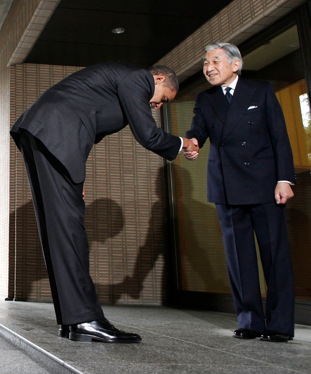 . U.S. President Barack Obama, left, bows as he is greeted by Japanese Emperor Akihito and Empress Michiko, not pictured, as he arrives at the Imperial Palace in Tokyo, Saturday, Nov. 14, 2009. Obama is on a two-day visit in Japan since Friday. (AP Photo/Charles Dharapak)