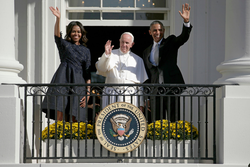 . President Barack Obama, first lady Michelle Obama and Pope Francis wave to the crowd on the South Lawn from the Truman Balcony of the White House in Washington, Wednesday, Sept. 23, 2015, during a state arrival ceremony. (AP Photo/Pablo Martinez Monsivais)