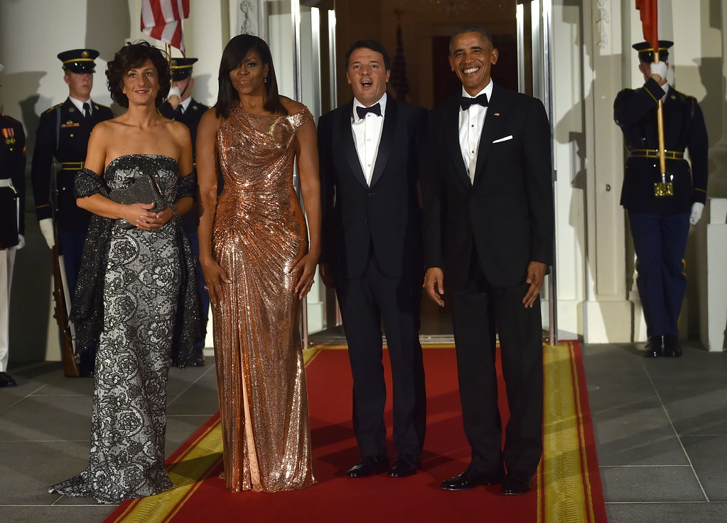 . US President Barack Obama (R) and First Lady Michelle Obama (2L) welcome Italian Prime Minister Matteo Renzi (2R) and his wife Agnese Landini on the North Portico of the White House before a state dinner in Washington, DC on October 18, 2016. (NICHOLAS KAMM/AFP/Getty Images)