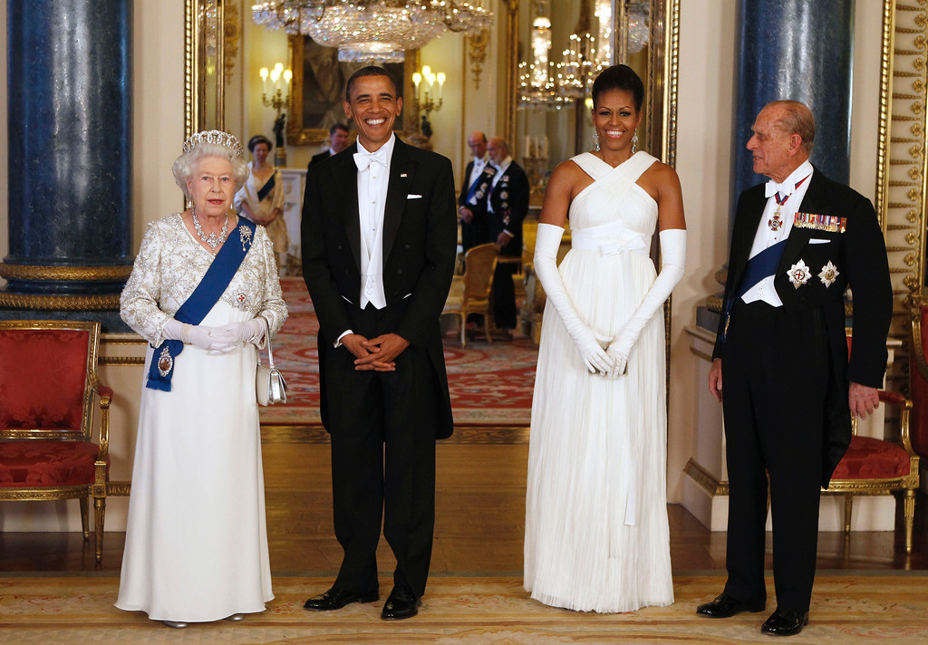 . FILE - In this May 24, 2011 file photo President Barack Obama, first lady Michelle Obama, Queen Elizabeth II, and Prince Philip pose for photographers prior to a dinner hosted by the queen at Buckingham Palace in London. With his departure from Berlin on Friday, Nov. 18, 2016 Obama will leave Europe for the last time as U.S. President. (Larry Downing/Pool photo via AP, file)