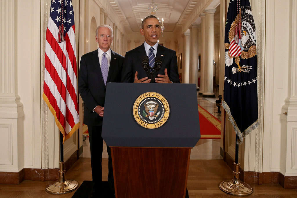 . President Barack Obama, standing with Vice President Joe Biden, delivers remarks in the East Room of the White House in Washington, Tuesday, July 14, 2015, after an Iran nuclear deal is reached.  Obama says every path to a nuclear weapon will be cut off from Iran under a historic agreement announced in Vienna. (AP Photo/Andrew Harnik, Pool)