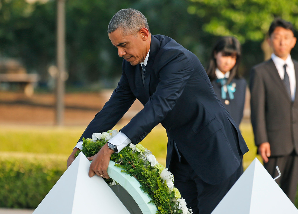 . U.S. President Barack Obama lays wreaths at the cenotaph at Hiroshima Peace Memorial Park in Hiroshima, western Japan, Friday, May 27, 2016. Obama on Friday became the first sitting U.S. president to visit the site of the world\'s first atomic bomb attack, bringing global attention both to survivors and to his unfulfilled vision of a world without nuclear weapons. (AP Photo/Shuji Kajiyama)