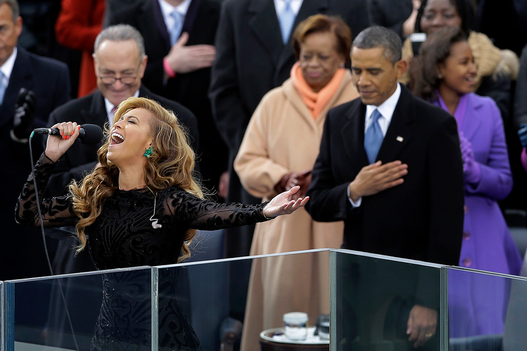 ". FILE - This Jan. 21, 2013 file photo shows President Barack Obama, right, as Beyonce sings the National Anthem at the ceremonial swearing-in at the U.S. Capitol during the 57th Presidential Inauguration in Washington. On Wednesday, President-elect Donald Trump picked ""America\'s Got Talent\"" star Jackie Evancho to sing the national anthem at his inauguration.  (AP Photo/Carolyn Kaster, File)"