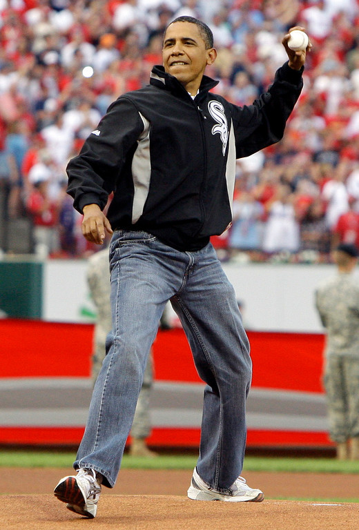. President Barack Obama throws out the first pitch to St. Louis Cardinals first baseman Albert Pujols, not pictured, before the MLB All-Star baseball game in St. Louis, Tuesday, July 14, 2009. (AP Photo/Haraz N. Ghanbari)