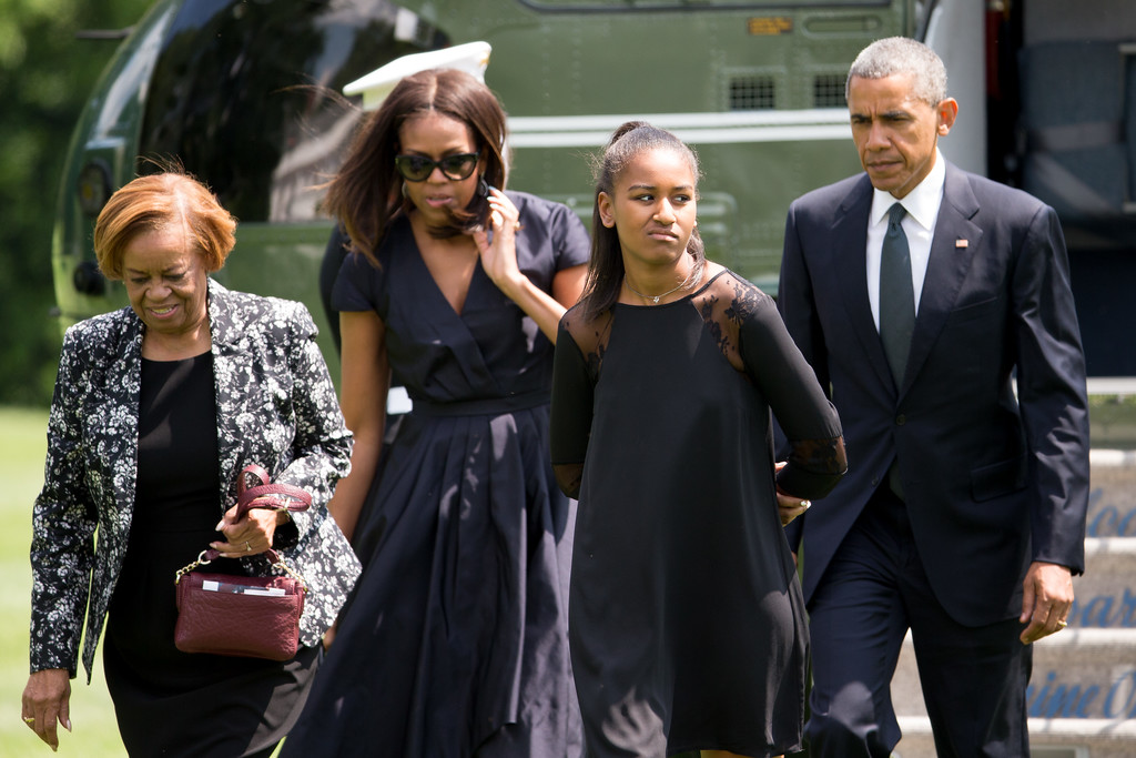 . President Barack Obama, and his family, first lady Michelle Obama, daughter Sasha Obama, and mother-in-law Marian Robinson, exit Marine One on the South Lawn of the White House in Washington, Saturday, June 6, 2015, after arriving from Andrews Air Force Base, Md., after traveling to Wilmington, Del. for a full Catholic Mass honoring Beau Biden, the vice president�s eldest son. Biden died of brain cancer at the age 46. (AP Photo/Andrew Harnik)