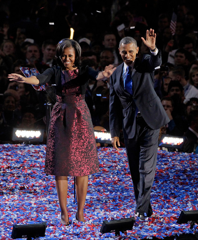 . President Barack Obama along with first lady Michelle Obama acknowledge the crowd at his election night party Wednesday, Nov. 7, 2012, in Chicago. President Obama defeated Republican challenger former Massachusetts Gov. Mitt Romney. (AP Photo/Nam Y. Huh)
