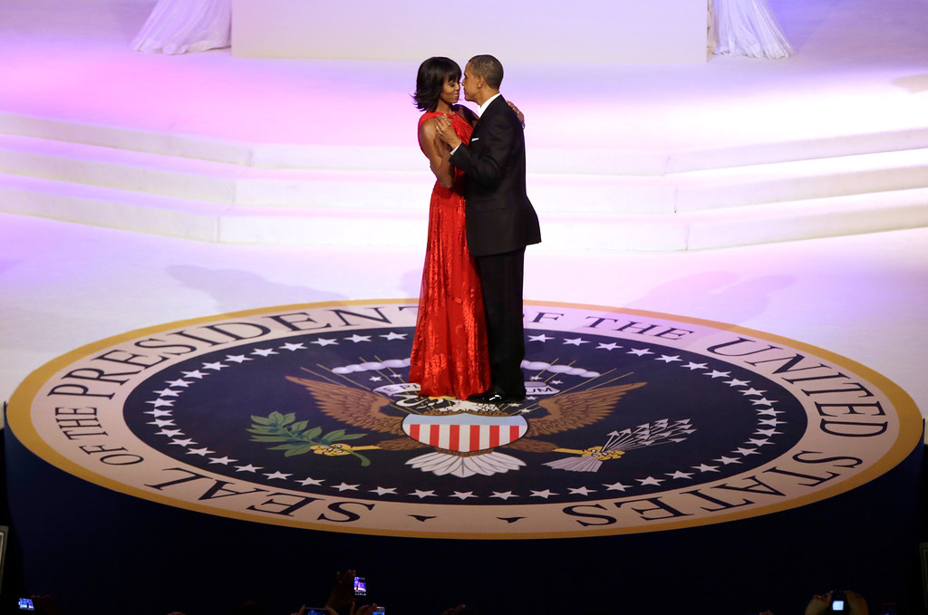 . President Barack Obama and first lady Michelle Obama dance during the Commander-In-Chief Inaugural ball at the Washington Convention Center during the 57th Presidential Inauguration Monday, Jan. 21, 2013 in Washington.  (AP Photo/ Evan Vucci)