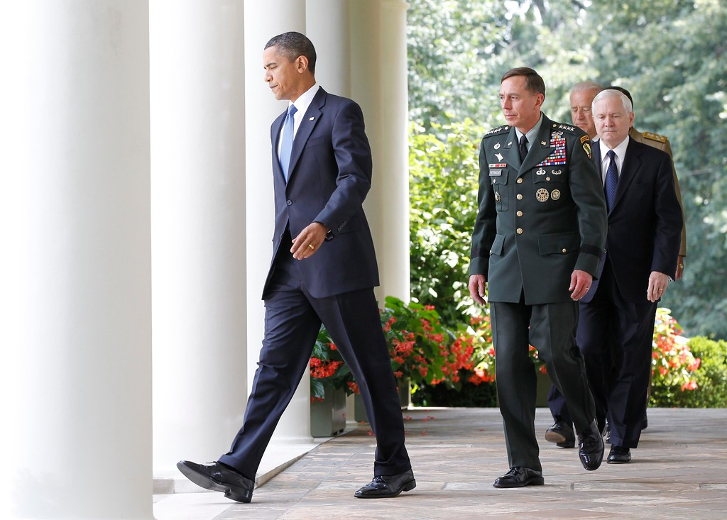 . President Barack Obama, followed by, from second from left,  Gen. David Petraeus, Defense Secretary Robert Gates, Vice President Joe Biden, and Joint Chiefs Chairman Adm. Michael Mullen, walks to the Rose Garden of the White House in Washington, Wednesday, June 23, 2010, to announce that Petraeus would replace Gen. Stanley McChrystal. (AP Photo/Charles Dharapak)