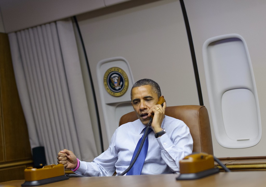 . US President Barack Obama speaks on the phone to natioinal volunteer leaders in  battleground states from Air Force One while travelling from Denver to Los Angeles on October 24, 2012. (MANDEL NGAN/AFP/Getty Images)