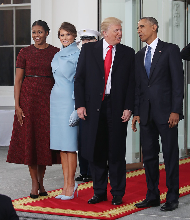 . WASHINGTON, DC - JANUARY 20: President-elect Donald Trump (2ndR),and his wife Melania Trump (2ndL), are greeted by President Barack Obama and his wife first lady Michelle Obama, upon arriving at the White House on January 20, 2017 in Washington, DC. Later in the morning President-elect Trump will be sworn in as the nation\'s 45th president during an inaugural ceremony at the U.S. Capitol.