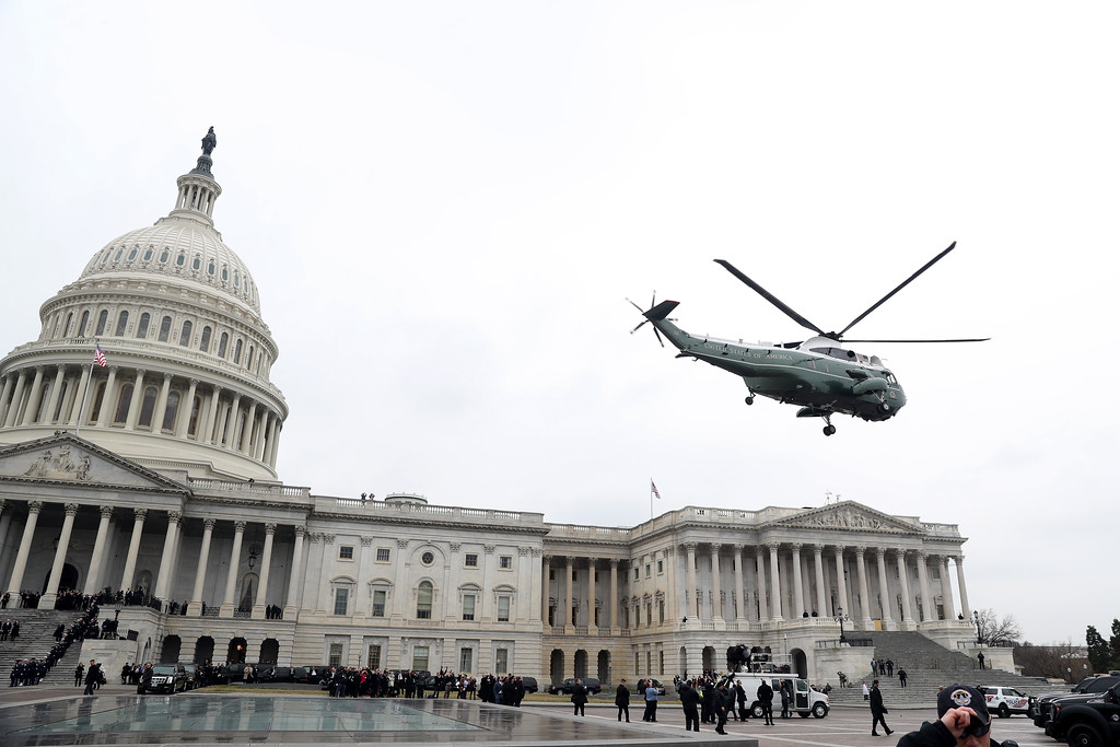 . WASHINGTON, DC - JANUARY 20:  WASHINGTON, DC - JANUARY A military helicopter carries former president Barack Obama and Michelle Obama from the U.S. Capitol on January 20, 2017 in Washington, DC. In today\'s inauguration ceremony Donald J. Trump becomes the 45th president of the United States.  (Photo by Rob Carr/Getty Images)