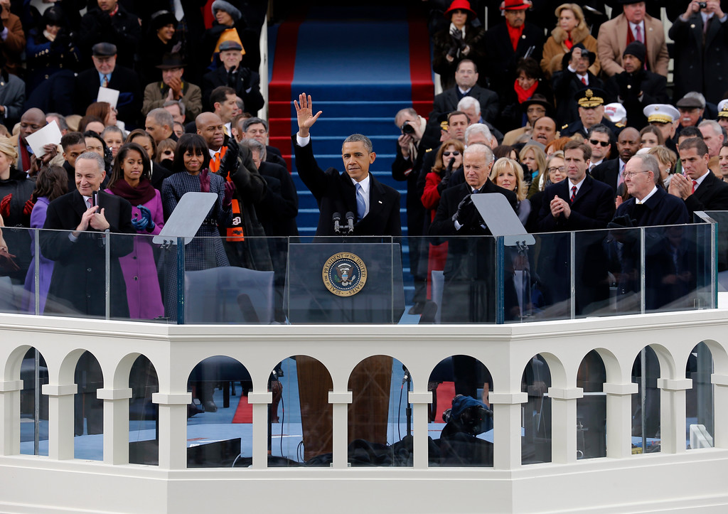 . FILE - In this Jan. 21, 2013, photo, President Barack Obama waves to crowd after his inaugural speech at the ceremonial swearing-in on the West Front of the U.S. Capitol during the 57th Presidential Inauguration in Washington. Gay rights advocates are renewing their push for President Barack Obama to sign an executive order banning federal contractors from discriminating against gay employees. The drive comes as Obama included an unexpected declaration of support for gay rights in the speech.  (AP Photo/Scott Andrews, Pool)