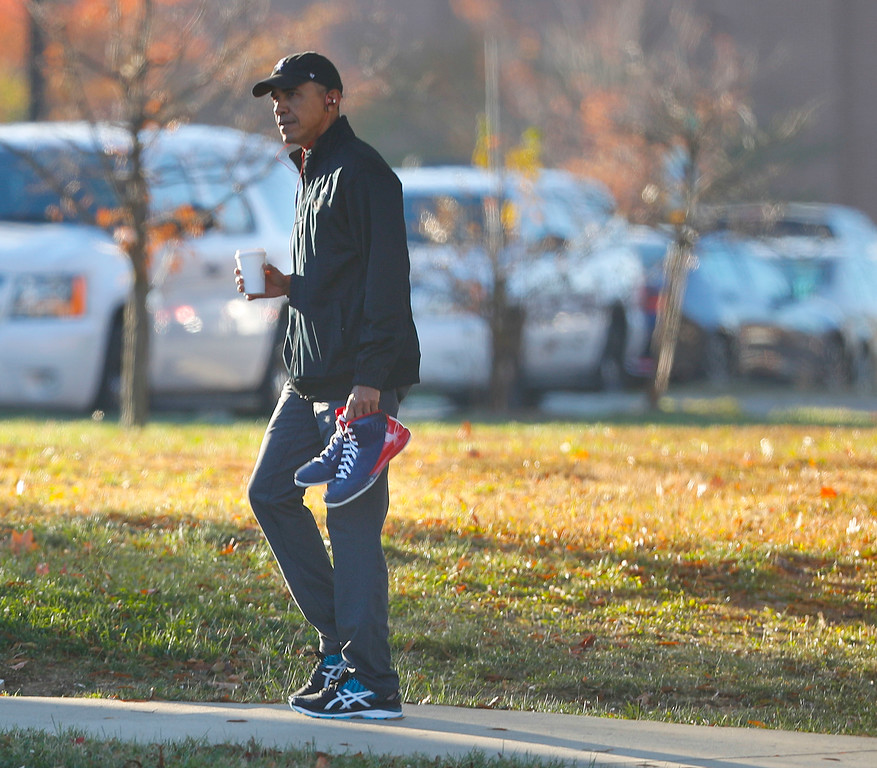 . President Barack Obama carries a pair of sneakers as he arrives for a private game of basketball at Fort McNair in Washington, Tuesday, Nov. 8, 2016. Playing basketball on election day is a tradition for Obama. (AP Photo/Pablo Martinez Monsivais)