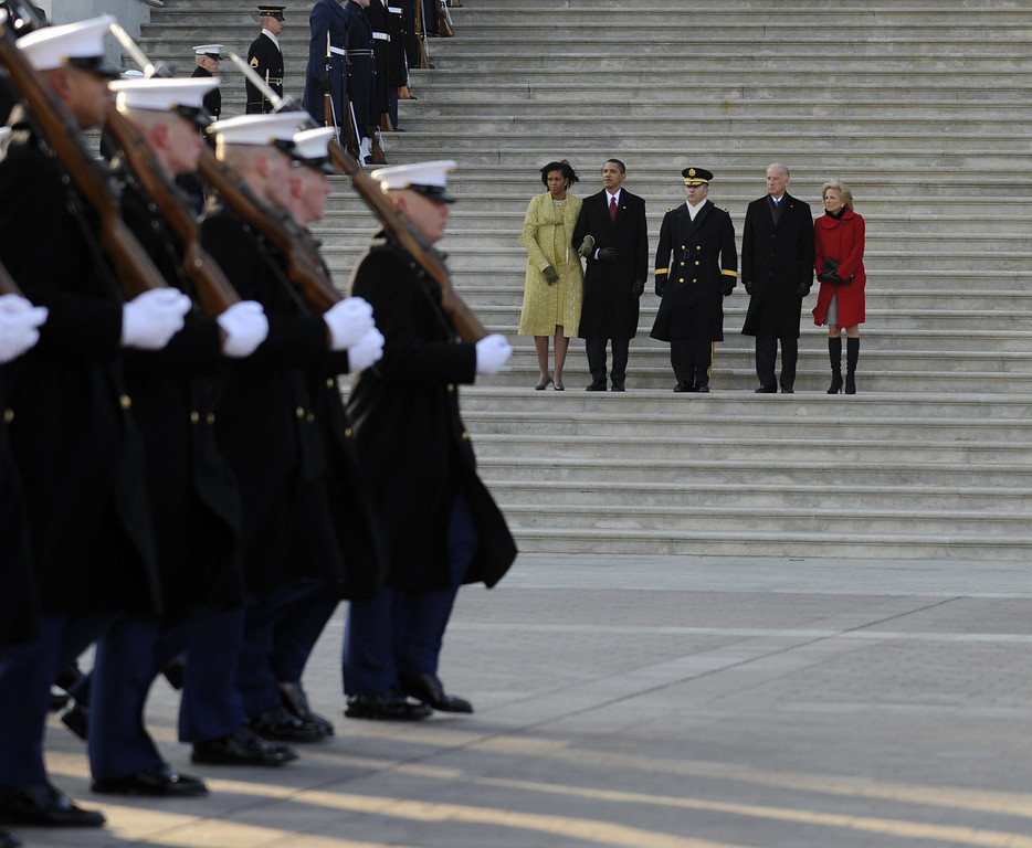 . President Barack Obama, his wife Michelle (L), Vice President Joseph Biden (2-R) and his wife Jill (R) are escorted by Major General Richard Rowe as they review the troops from the steps of the US Capitol Building after Obama was sworn in as the 44th President of the United States during the 56th Presidential Inauguration ceremony in Washington, DC, 20 January 2009.   (ANNEN MAURY/AFP/Getty Images)