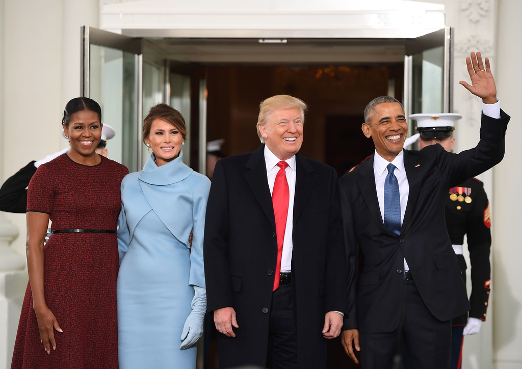 . US President Barack Obama(R) and First Lady Michelle Obama(L) welcome Preisdent-elect Donald Trump(2nd-R) and his wife Melania to the White House in Washington, DC January 20, 2017.  (JIM WATSON/AFP/Getty Images)