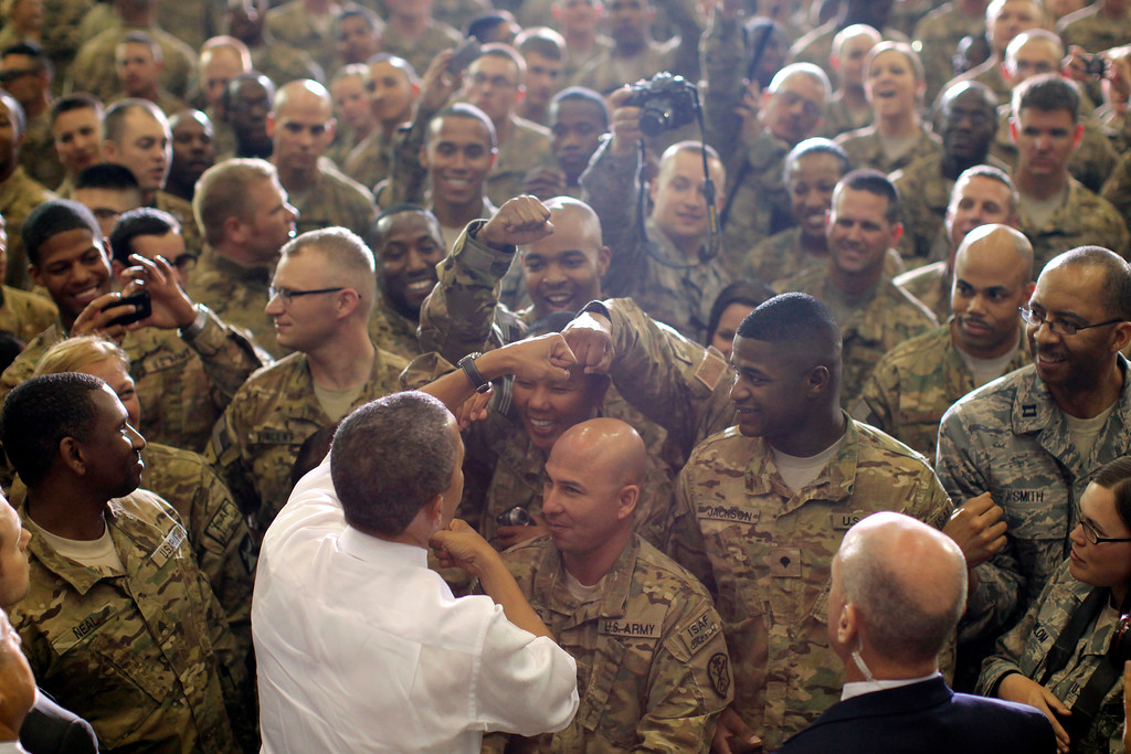 . President Barack Obama fist bumps service members after he addressed troops at Bagram Air Field, Afghanistan, Wednesday, May 2, 2012. (AP Photo/Charles Dharapak)