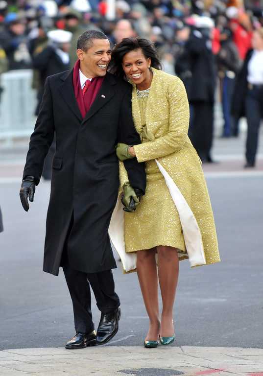 . WASHINGTON - JANUARY 20:  President Barack Obama and first lady Michelle Obama walk in the Inaugural Parade on January 20, 2009 in Washington, DC. Obama was sworn in as the 44th President of the United States, becoming the first African-American to be elected President of the US.  (Photo by Ron Sachs-Pool/Getty Images)