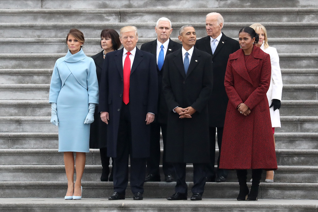 . WASHINGTON, DC - JANUARY 20: (From L to R) First Lady Melania Trump, Karen Pence, President Donald Trump, Vice President Mike Pence, former president Barack Obama, former vice president Joe Biden, Michelle Obama and Jill Biden stand on the steps of the U.S. Capitol on January 20, 2017 in Washington, DC. In today\'s inauguration ceremony Donald J. Trump becomes the 45th president of the United States.  (Photo by Rob Carr/Getty Images)