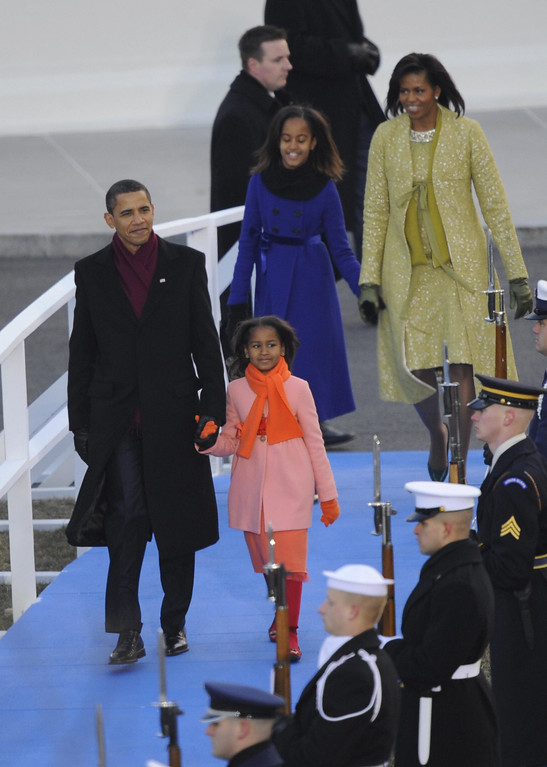. US President Barack Obama, First Lady Michelle and daughters Sacha(front) and Malia step out of the White House to watch the Inaugural Parade from a reviewing stand set up in front of the White House, following Obama inauguration ceremony as 44th US president January 20, 2009, in Washington, DC. Obama and Michelle twice stepped from of their limousine and out onto Pennsylvania Avenue to walk down the route taking them to the White House.  (EMMANUEL DUNAND/AFP/Getty Images)