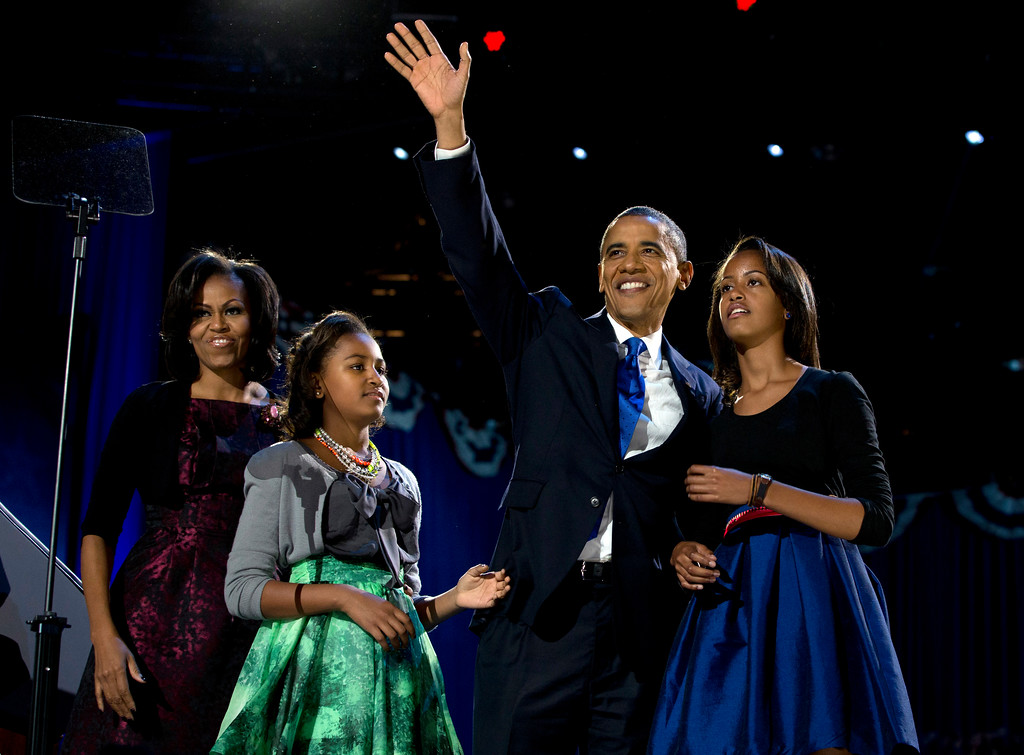 . President Barack Obama waves as he walks on stage with first lady Michelle Obama and daughters Malia and Sasha at his election night party Wednesday, Nov. 7, 2012, in Chicago. Obama defeated Republican challenger former Massachusetts Gov. Mitt Romney. (AP Photo/Carolyn Kaster)