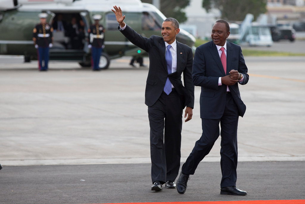 . Kenyan President Uhuru Kenyatta, right, escorts President Barack Obama as he while departing Kenyatta International Airport, on Sunday, July 26, 2015, in Nairobi. On the final day of his visit in Kenya, Obama laid out his vision for Kenya\'s futurevand broad themes of U.S.-Kenya relations. (AP Photo/Evan Vucci)