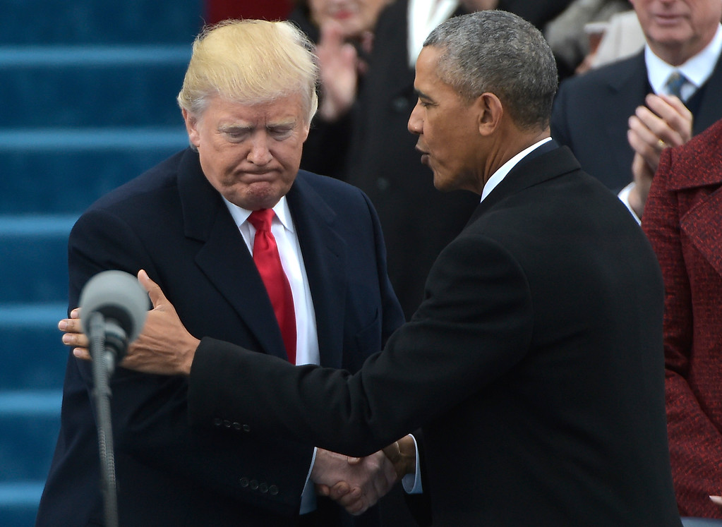 . US President Barack Obama (R) greets President-elect Donald Trump as he arrives on the platform at the US Capitol in Washington, DC, on January 20, 2017, before his swearing-in ceremony. (MANDEL NGAN/AFP/Getty Images)