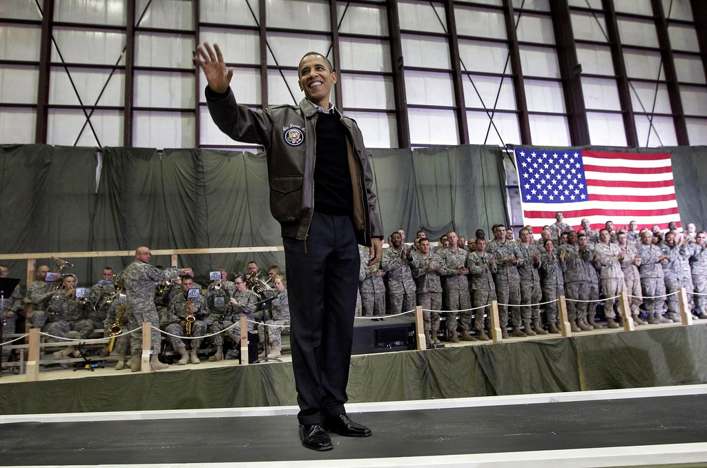 . President Barack Obama is introduced to the troops during a rally in an unannounced visit at Bagram Air Field in Afghanistan, Friday, Dec. 3, 2010.(AP Photo/Pablo Martinez Monsivais)