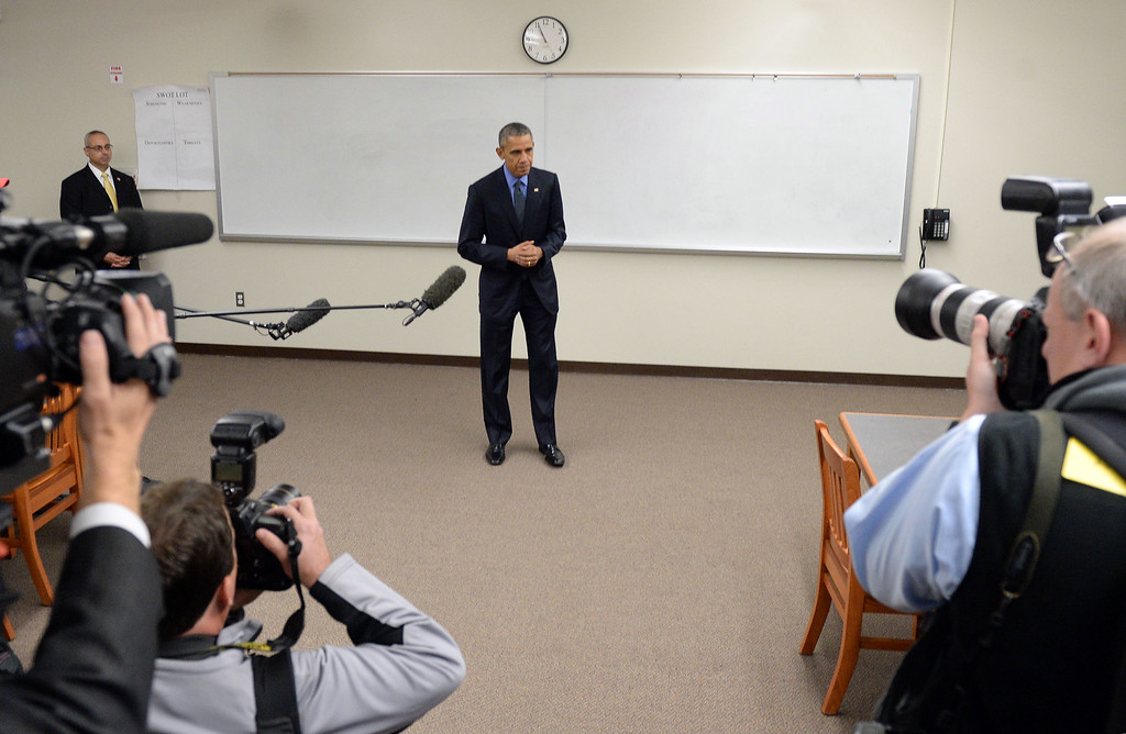 . President Barack Obama makes a brief statement in a classroom at Indian Springs High School Friday evening December 18, 2015. The President and the First Lady met with family members of those killed during a mass shooting that left 14 dead at the Inland Regional Center in San Bernardino Dec. 2.(POOL PHOTO Will Lester/San Bernardino Sun)