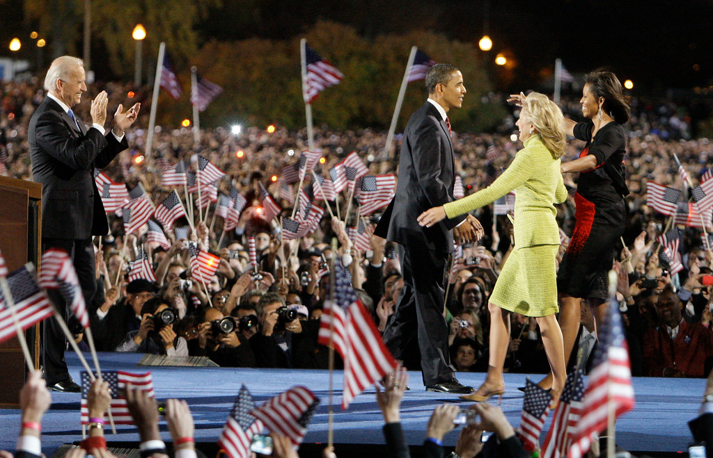 . President-elect Barack Obama and Vice president-elect Joe Biden, left, are joined by their wives Michelle Obama and Jill Biden  during their election night party at Grant Park in Chicago, Tuesday night, Nov. 4, 2008. (AP Photo/M. Spencer Green)