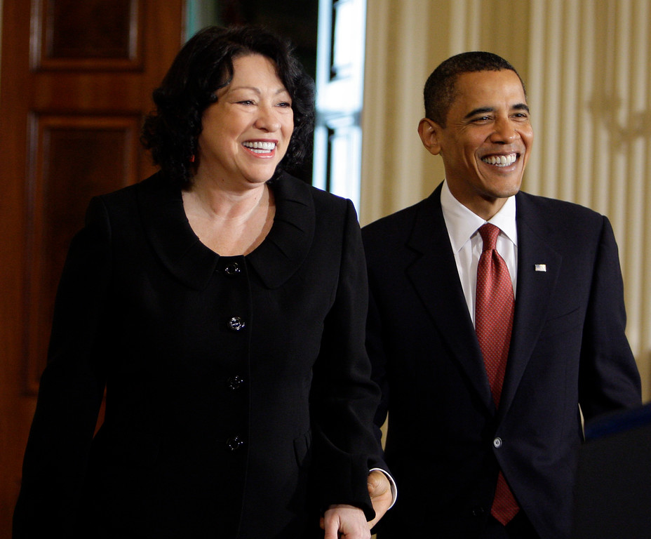 . President Barack Obama and new Supreme Court Justice Justice Sonia Sotomayor enter the East Room of the White House in Washington, Wednesday, Aug. 12, 2009, for a reception in her honor. (AP Photo/Alex Brandon)