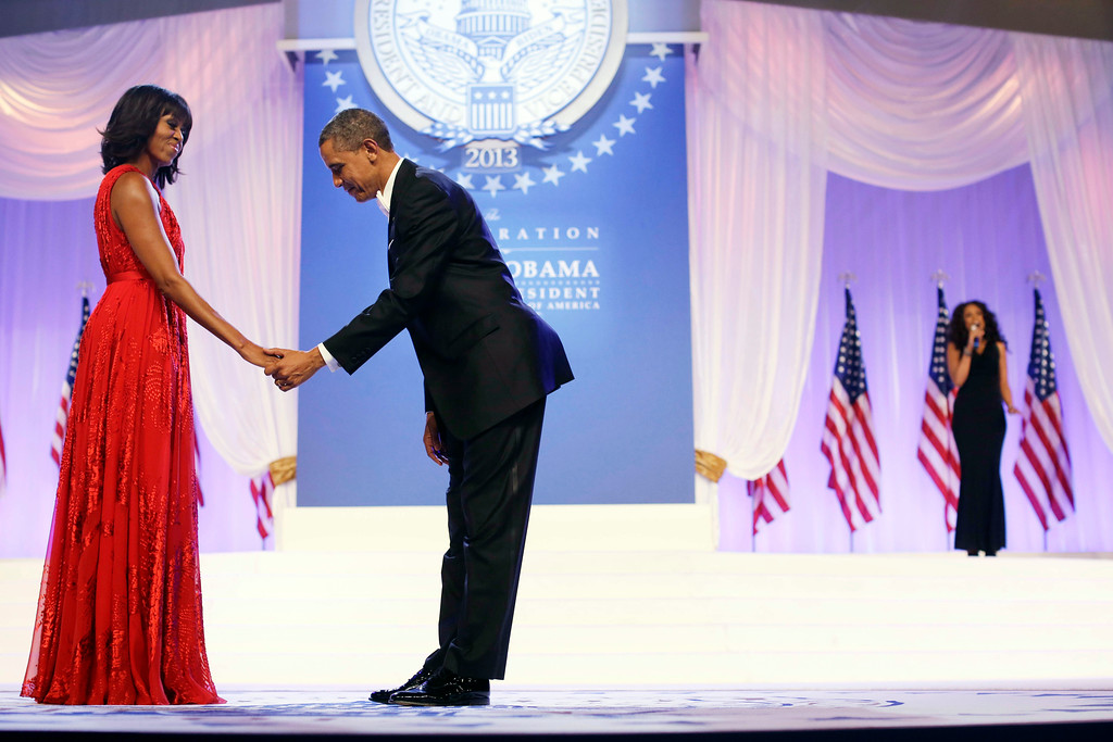 ". President Barack Obama bows as he and first lady Michelle Obama, wearing a ruby colored chiffon and velvet Jason Wu gown, gets ready to dance as singer Jennifer Hudson, right, sings Al Green\'s ""Let\'s Stay Together\"" at the Inaugural Ball at the Washington Convention Center during the 57th Presidential Inauguration in Washington, Monday, Jan. 21, 2013. (AP Photo/Charles Dharapak)"