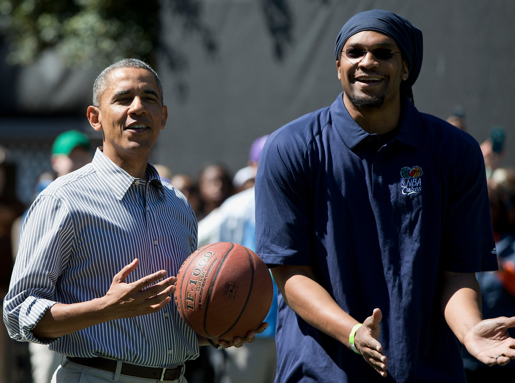. President Barack Obama and former NBA basketball player Etan Thomas play basketball during the annual White House Easter Egg Roll, Monday, April 21, 2014, on the court on the South Lawn of the White House in Washington. Thousands of children gathered at the White House for the annual Easter Egg Roll. This year\'s event features live music, cooking stations, storytelling, and of course, some Easter egg rolling. (AP Photo/Carolyn Kaster)