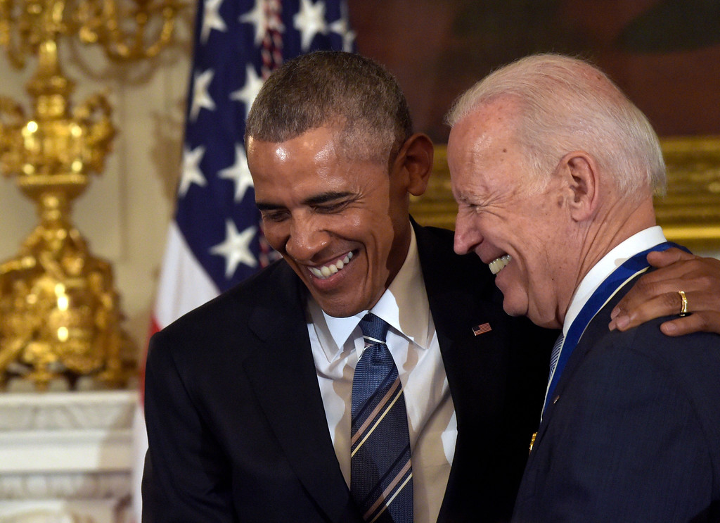 . President Barack Obama laughs with Vice President Joe Biden during a ceremony in the State Dining Room of the White House in Washington, Thursday, Jan. 12, 2017. Obama presented Biden with the Presidential Medal of Freedom. (AP Photo/Susan Walsh)
