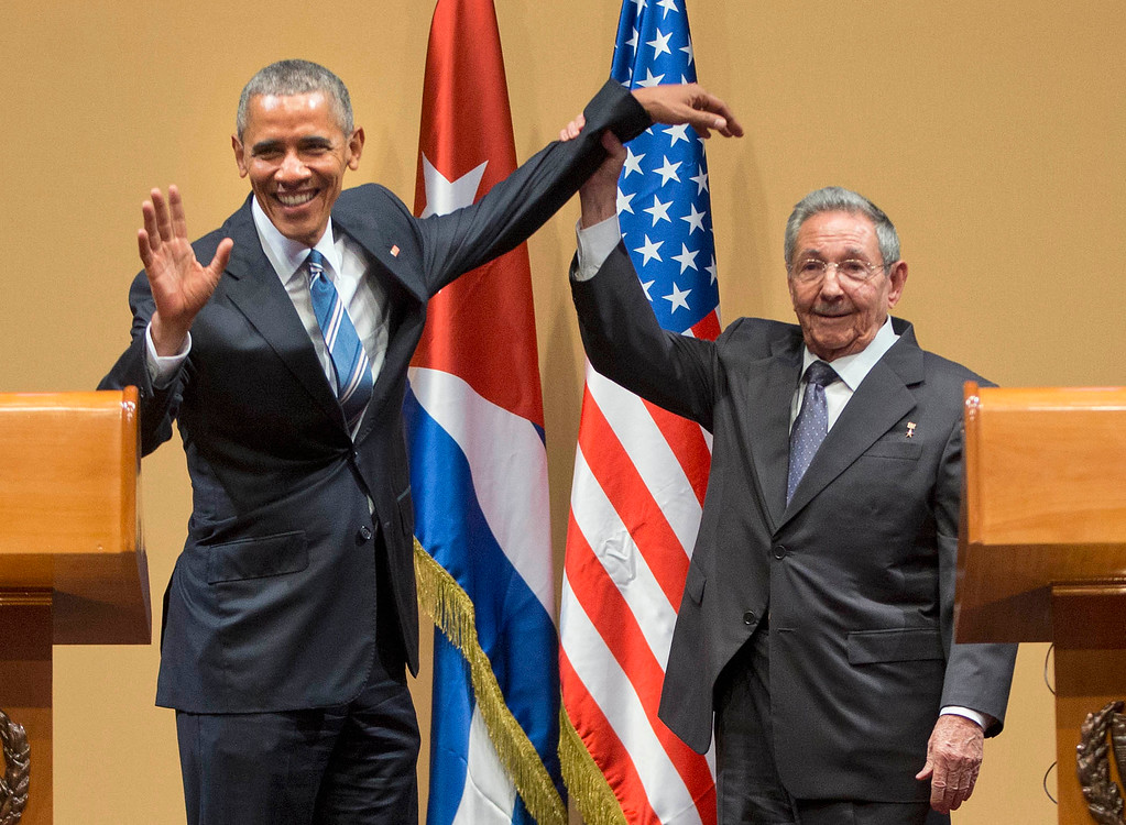 . Cuban President Raul Castro lifts up the arm of President Barack Obama at the conclusion of their joint news conference at the Palace of the Revolution, Monday, March 21, 2016 in Havana, Cuba. (AP Photo/Pablo Martinez Monsivais)