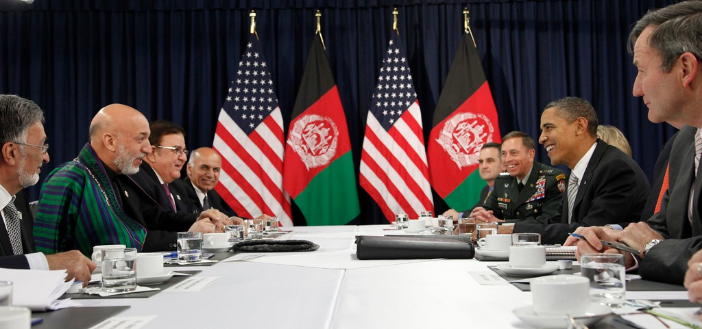 . U.S. President Barack Obama, second from right, and Afghanistan President Hamid Karzai, second from left, take part in a bilateral meeting during the NATO Summit in Lisbon, Portugal, Saturday, Nov. 20, 2010. (AP Photo/Pablo Martinez Monsivais)