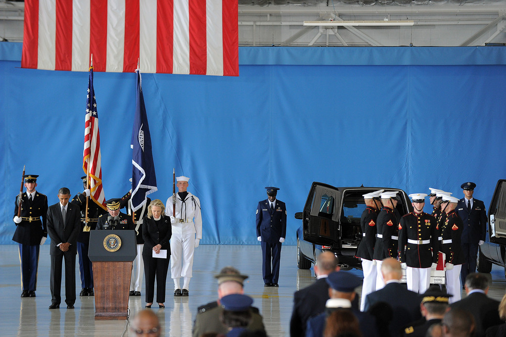 . US President Barack Obama and Secretary of State Hillary Clinton pray during the transfer of remains ceremony marking the return to the US of the remains of the four Americans killed in an attack this week in Benghazi, Libya, at the Andrews Air Force Base in Maryland on September 14, 2012. US Ambassador Christopher Stevens died on Tuesday along with three other Americans in the assault on the consular building in Benghazi, on the 11th anniversary of the September 11 attacks. (JEWEL SAMAD/AFP/GettyImages)