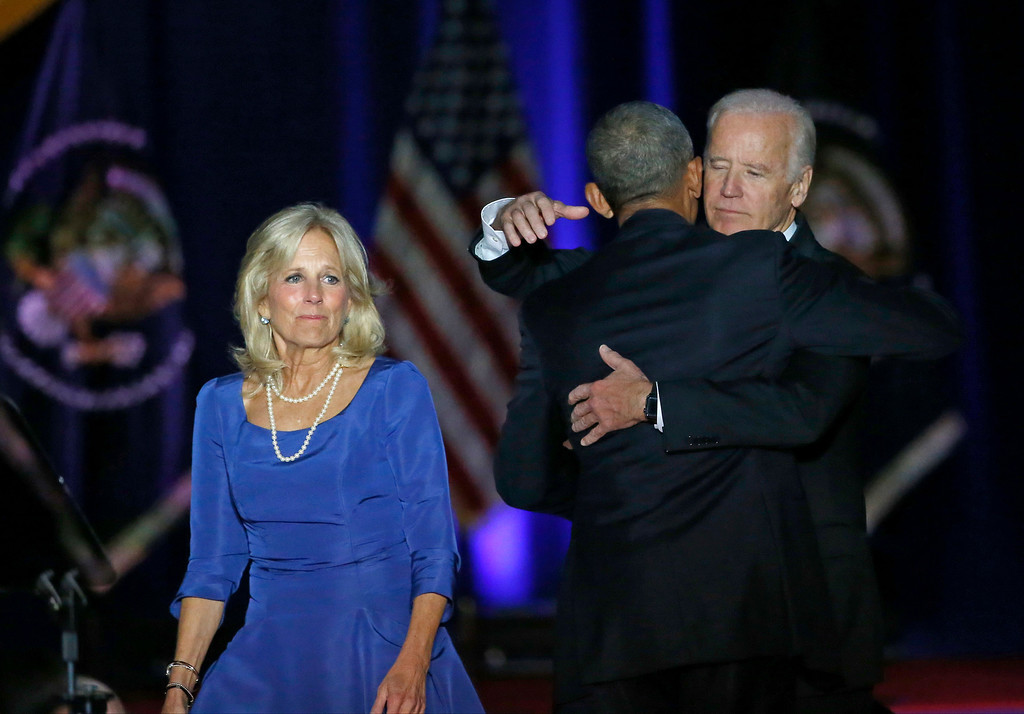 . President Barack Obama is greeted by Vice President Joe Biden, right, and Dr. Jill Biden after giving his presidential farewell address at McCormick Place in Chicago, Tuesday, Jan. 10, 2017. (AP Photo/Charles Rex Arbogast)