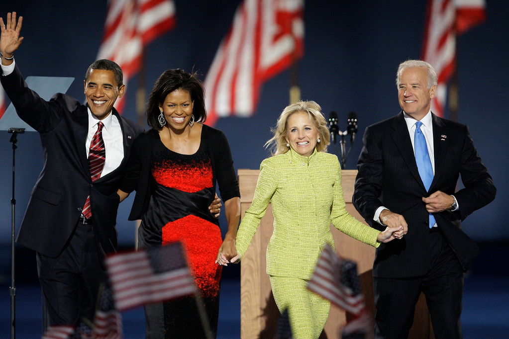 . President-elect Barack Obama and his wife, Michelle, left, and Vice President-elect Joe Biden and his wife, Jill, wave to the crowd after Obama\'s acceptance speech at his election night party at Grant Park in Chicago, Tuesday night, Nov. 4, 2008.  (AP Photo/Morry Gash)